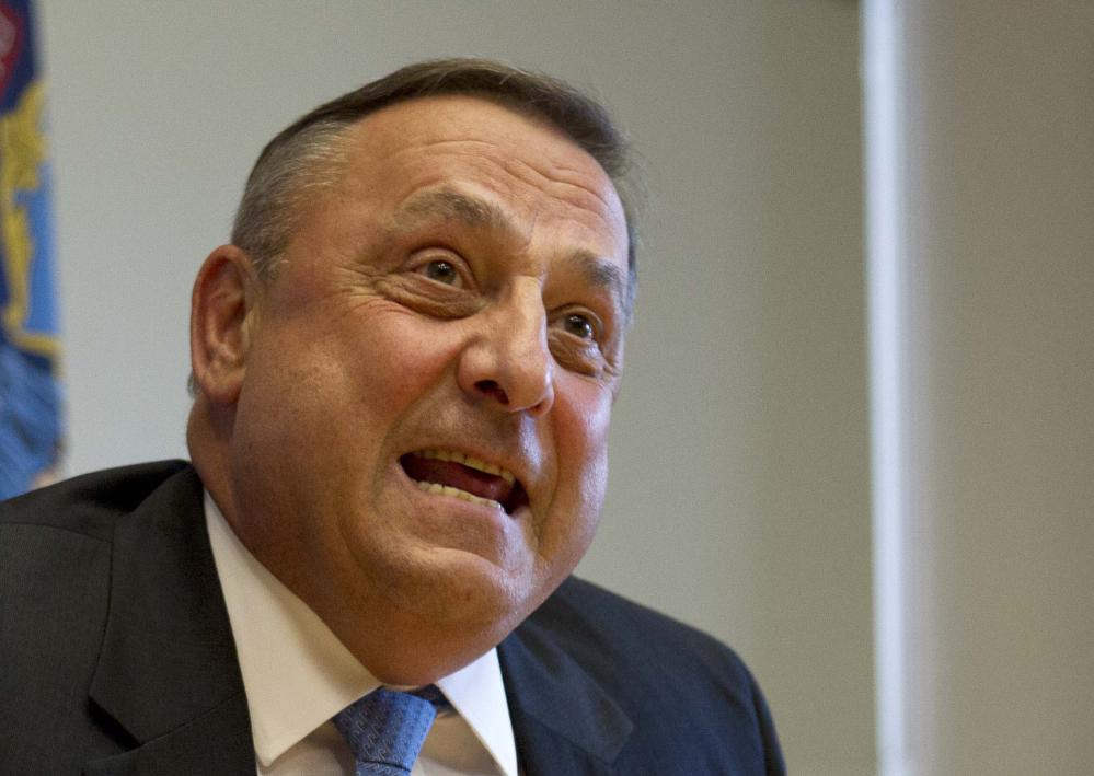 Maine Gov. Paul LePage speaks to reporters at the State House in Augusta.