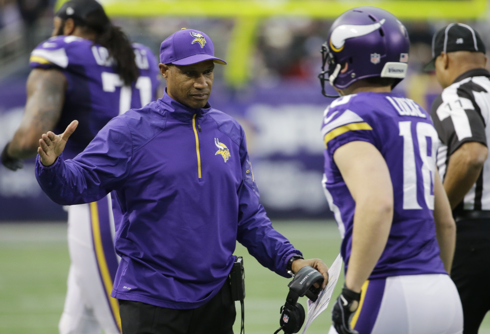 Minnesota Vikings head coach Leslie Frazier, left, reacts with punter Jeff Locke during the first half of an NFL football game against the Detroit Lions on Sunday in Minneapolis. The Vikings won 14-13.