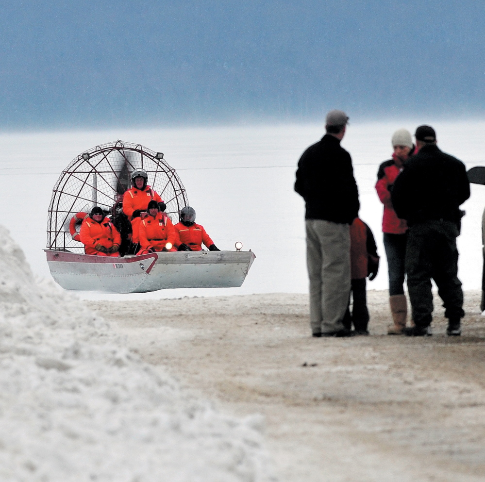 Maine Warden Service personnel return to shore in an airboat on Rangeley Lake in Rangeley after motoring over ice to the location where the snowmobile that Dawn Newell was riding broke through the ice in December 2012.