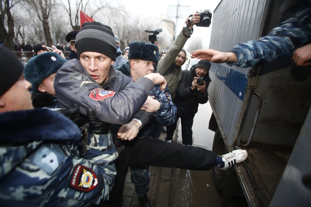 Police officers detain people who gathered for an unsanctioned event in downtown Volgograd, Russia, on Monday. Volgograd is about 400 miles northeast of Sochi, where the Olympics are to be held.
