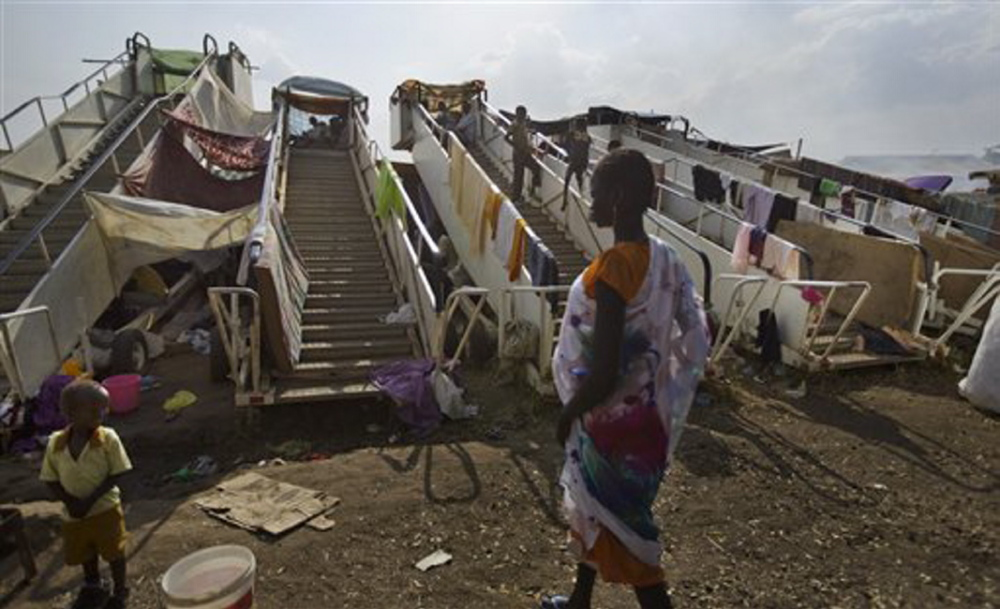 Moveable stairs used for passengers to board aircraft are repurposed into makeshift shelters by the displaced at a United Nations compound which has become home to thousands of people displaced by the recent fighting, in the capital Juba, South Sudan Sunday.