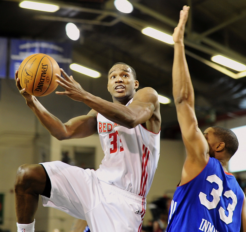 Red Claws Chris Wright takes it up for two over Delaware's JR Inman as Maine hosts the 87ers at the Portland Expo on Tuesday.