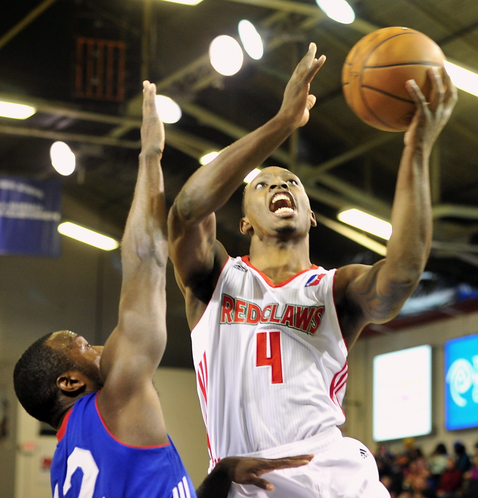 Red Claws Frank Gaines takes it up for two over Delaware's Mfon Udofia at the Portland Expo on Tuesday.