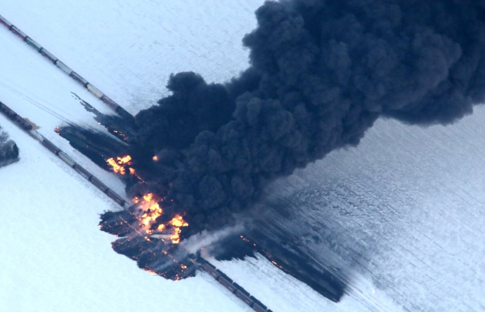 A fire from a train derailment burns uncontrollably as seen in this aerial photograph Monday, Dec. 30, 2013, west of Casselton, N.D. No one has been reported hurt in the derailment or fire.