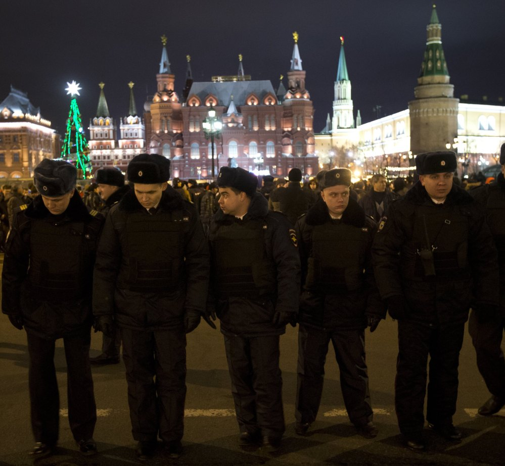 Russian police officers get ready to check people arriving at Red Square ahead of the New Year's Eve festivities in Moscow on Tuesday.