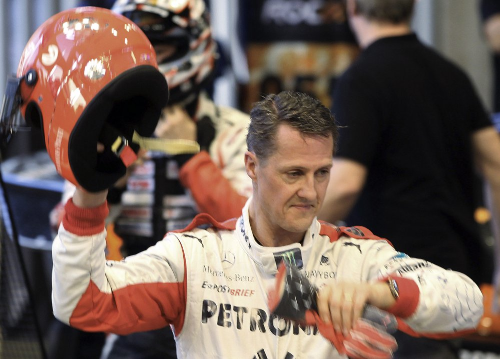 """Doctors in Grenoble, France, who are treating seven-time Formula One world champion Michael Schumacher said Tuesday, """"We cannot say he is out of danger,"""" after he suffered a head injury in a skiing accident in Meribel, France, on Sunday."""