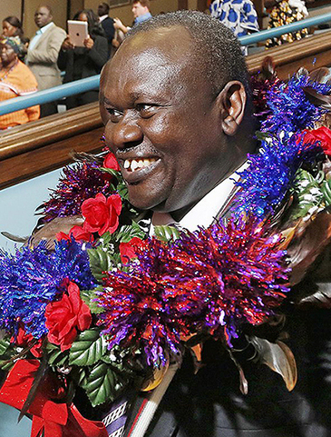 Rick Machar, vice president of South Sudan, is greeted during his visit to Portland in October 2012.