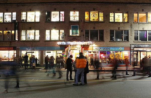 Pedestrians walk down a section of Congress Street closed to traffic during the First Friday Art Walk in Portland.