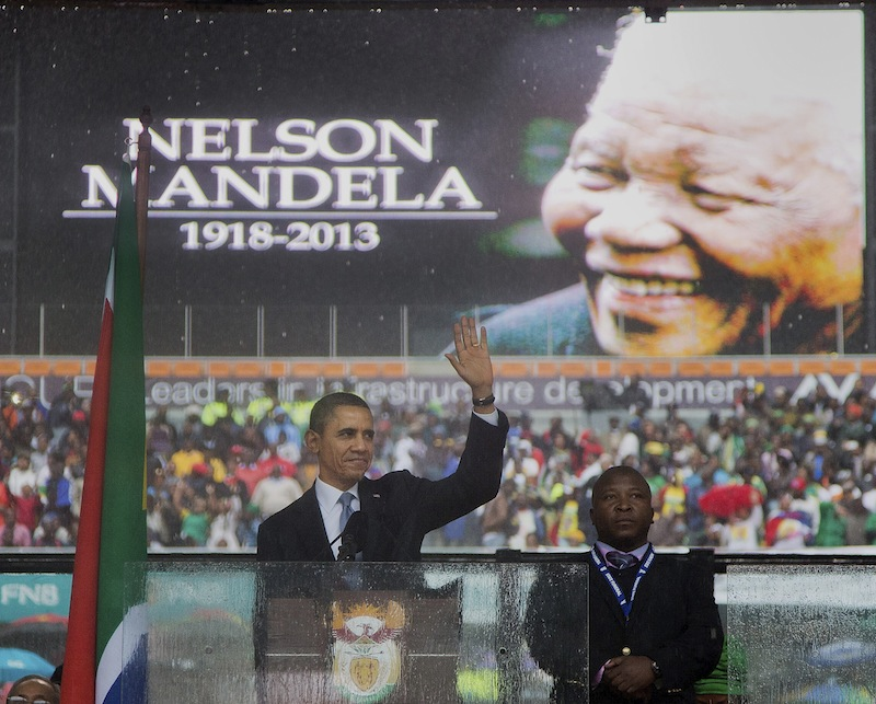President Barack Obama waves as he arrives to speak at the memorial service for former South African president Nelson Mandela at the FNB Stadium in the Johannesburg, South Africa township of Soweto, Tuesday, Dec. 10, 2013. World leaders, celebrities, and citizens from all walks of life gathered on Tuesday to pay respects during a memorial service for the former South African president and anti-apartheid icon.