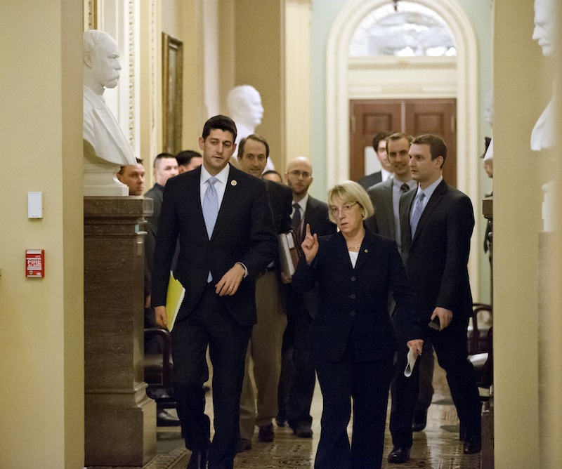 House Budget Committee Chairman Paul Ryan, R-Wis., left, and Senate Budget Committee Chairwoman Patty Murray, D-Wash., walk together on Dec. 10 to a news conference to announce a tentative agreement between Republican and Democratic negotiators on a government spending plan.