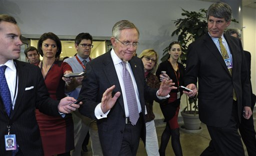 Reporters pursue Senate Majority Leader Harry Reid of Nevada, center, on Capitol Hill Wednesday.