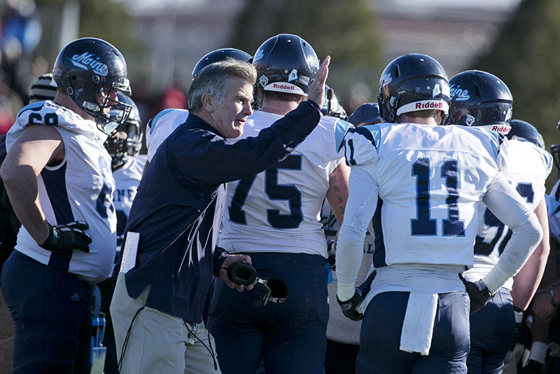 Maine Coach Jack Cosgrove pats the shoulder of Maine wide receiver John Ebeling after the loss to New Hampshire on Nov. 23. The Black Bears will be home for a playoff game against New Hampshire on Saturday.
