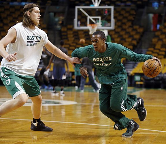 Boston Celtics' Rajon Rondo, right, works out with teammate Kelly Olynyk before an NBA basketball game against the Minnesota Timberwolves in Boston, Monday, Dec. 16, 2013.