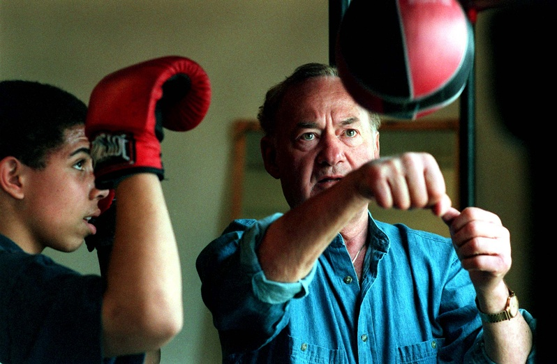 "Richard ""Dick"" Potvin shows Justin King the timing necessary to work on the speedbag at the Southern Maine Boxing Club in 1997. Potvin, who started the club, died Dec. 4. Gregory Rec"