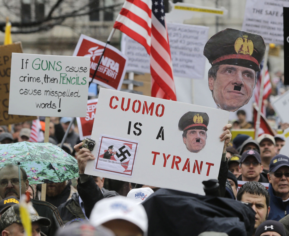 Gun rights advocates demonstrate in Albany, N.Y., last February. A gun-control law that was adopted in January 2013 limits sales of some weapons and ammunition.