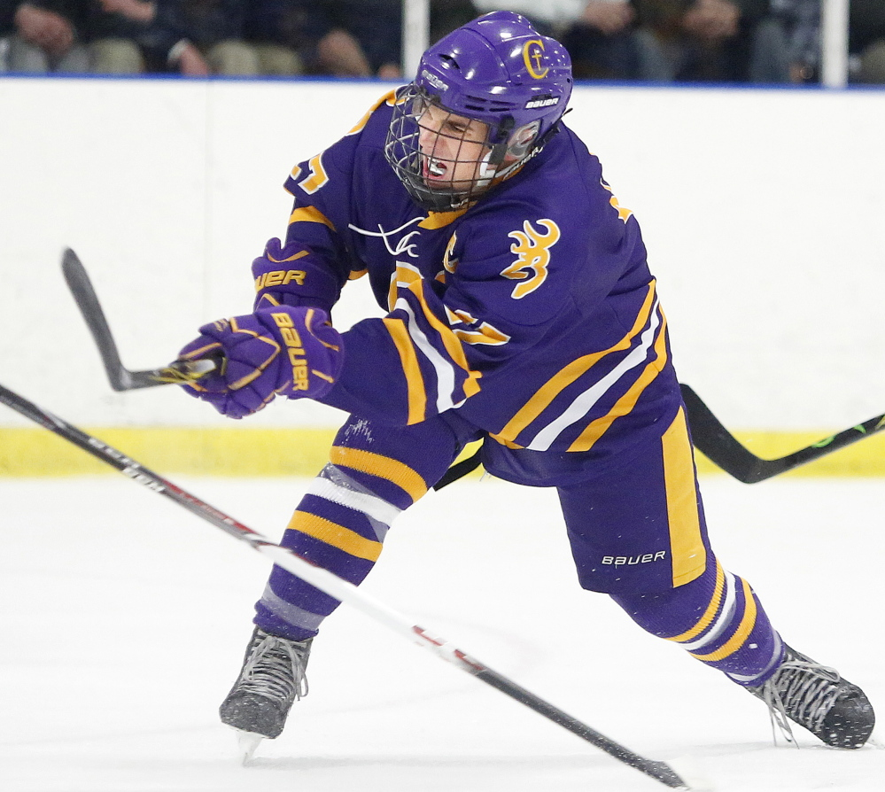 James Hannigan of Cheverus fires a shot during the third period Wednesday. Cheverus improved to 4-2. Portland/Deering is 2-2-1.