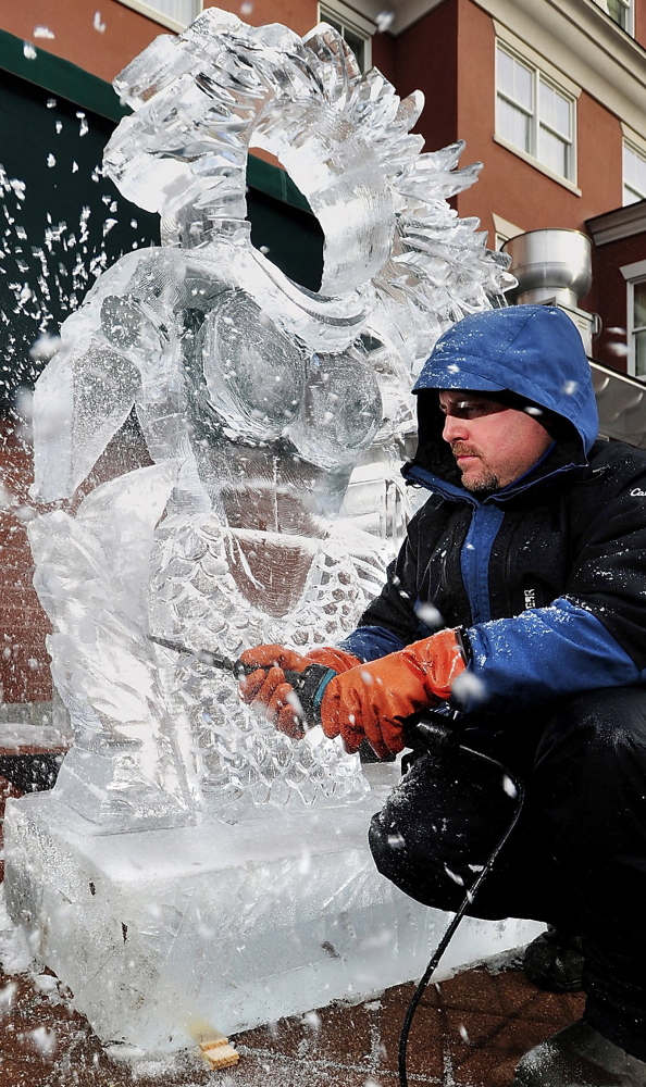 The ice chips fly as Jeff Day of Ice Designs in New Hampshire puts the finishing touches on a sculpture for the 2012 Portland Harbor Hotel Ice Bar.