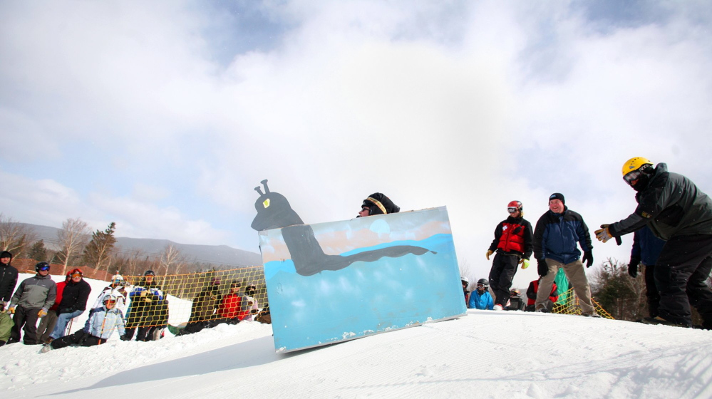 "A cardboard sled called ""The Mooselook Monster"" heads down the slope during the Cardboard Box Race at Saddleback Mountain in Rangeley in 2011."