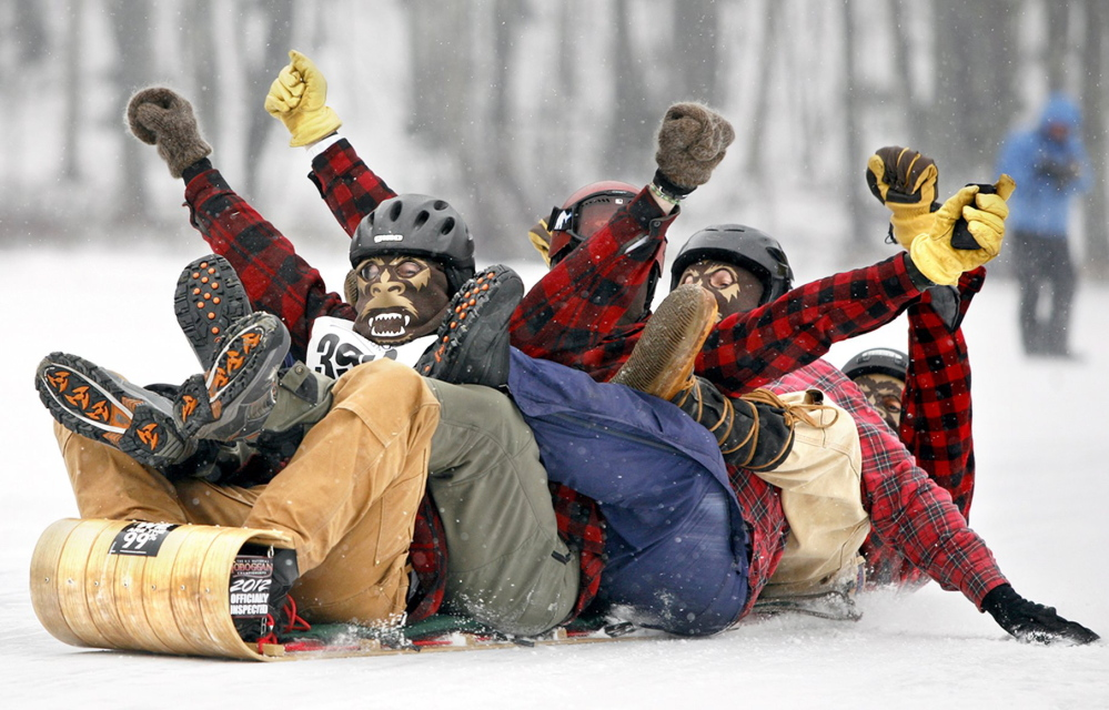 Members of team Fetching Yetis celebrate a successful run during the 22nd annual U.S. National Toboggan Championships at the Camden Snow Bowl in 2012.
