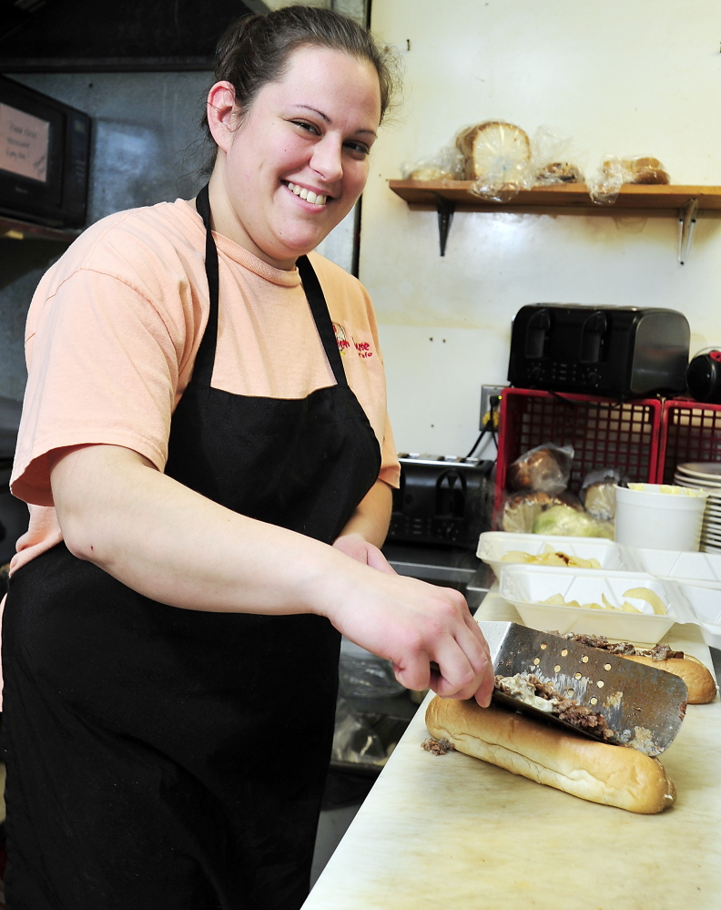 Jessica Elskamp makes two steak, mushroom and cheese sandwiches to go ...
