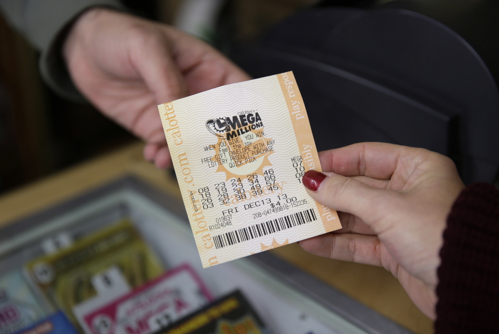 A woman purchases a Mega Millions lottery ticket at a San Francisco liquor store on Dec. 12, 2013. Steve Tran purchased his $324 million winning ticket in the Dec. 17 drawing in San Jose.