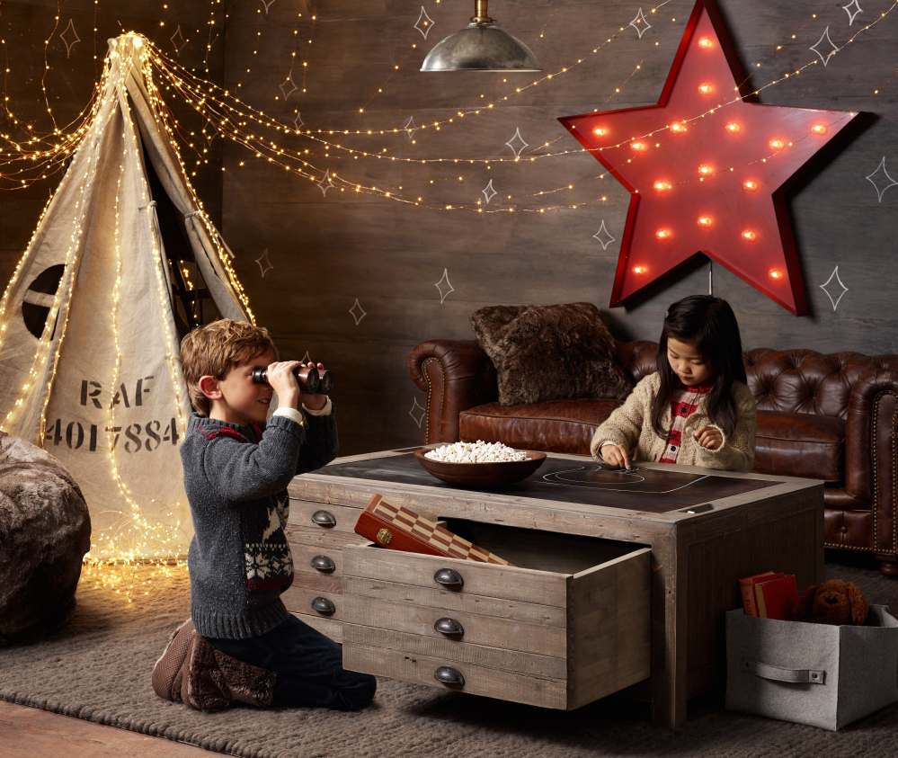This Restoration Hardware play table offers functional storage and room to get creative. The contemporary style appeals to those families today who want recreational spaces to blend with the rest of the home.