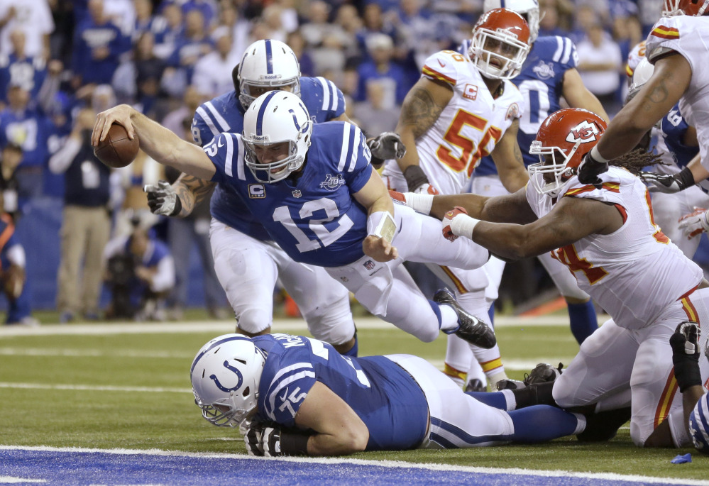Indianapolis Colts quarterback Andrew Luck (12) dives for a touchdown after recovering a fumble by the Colts' Eric Berry during the second half of an NFL wild-card playoff game against the Kansas City Chiefs on Saturday in Indianapolis.