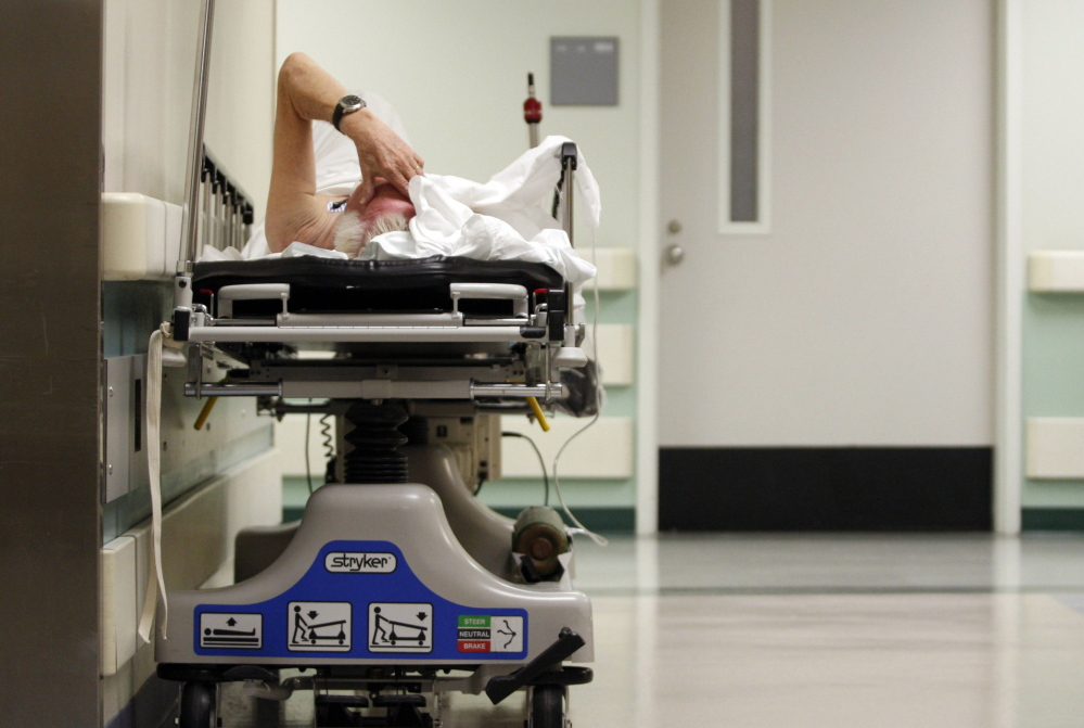 A patient waits in the hallway for a room to open up at a hospital in Houston, Texas. The U.S. health care system excels in treating patients in crisis, but the emphasis needs to shift to better preventive care if we're to see costs drop and outcomes improve, experts say.
