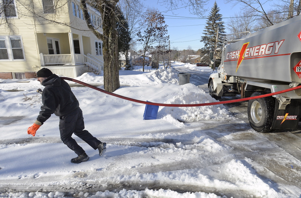 Tim Darnell of Cash Energy delivers oil in Portland last week. Three years ago, Maine received $56 million in federal heating assistance. This year, agencies are distributing $34 million. To make sure that money goes as far as it can, Congress should allocate more to home weatherization assistance.
