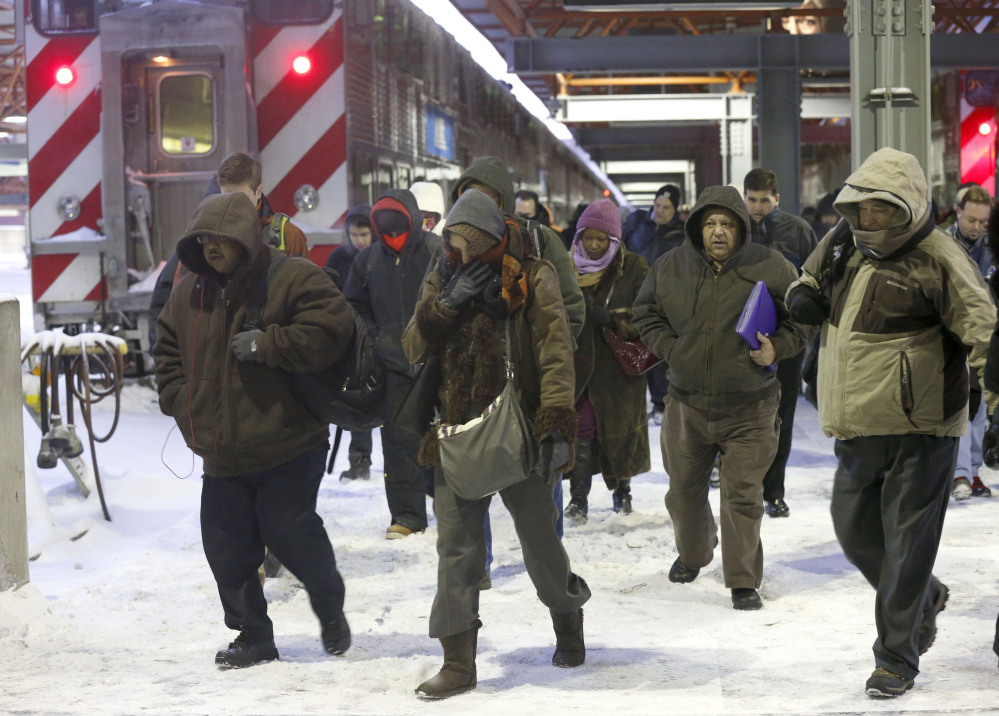Commuters arrive at the La Salle Street commuter rail station as they experience temperatures well below zero and wind chills expected to reach 40 to 50 below on Monday in Chicago.