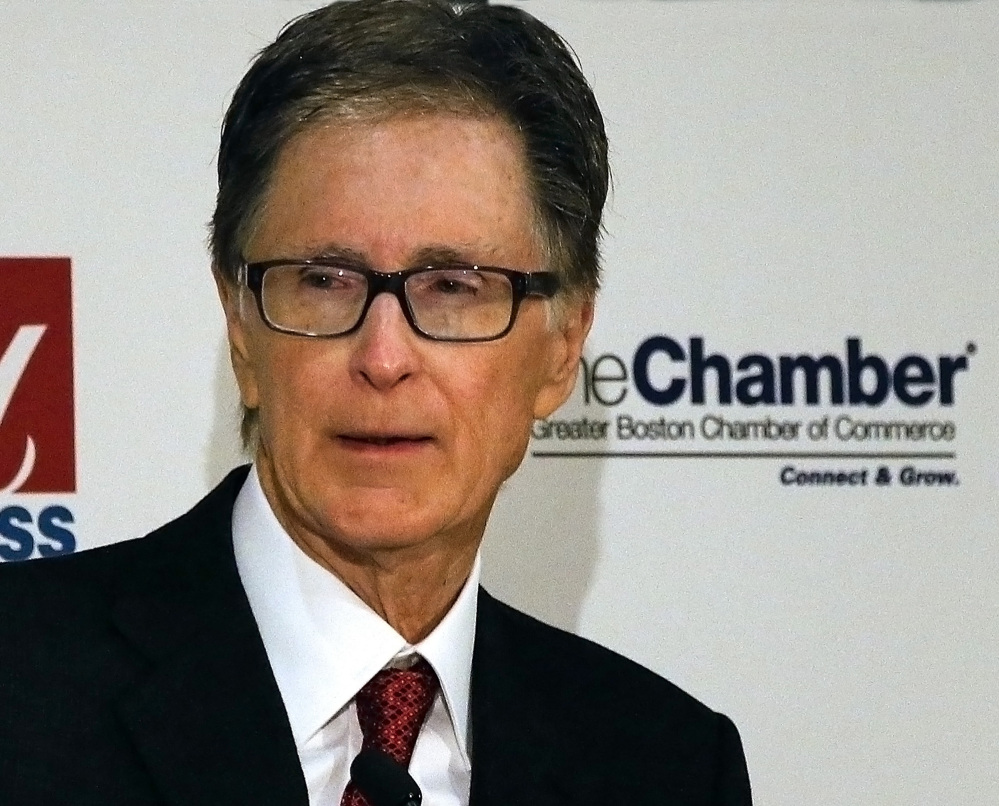 "Boston Red Sox owner John Henry speaks at the Greater Boston Chamber of Commerce breakfast meeting at the Mandarin Oriental Hotel in Boston, Wednesday, Jan. 8 2014. Henry, who recently purchased The Boston Globe, said Wednesday at the breakfast that the newspaper would work to remain ""aggressively relevant"" in the changing media environment."