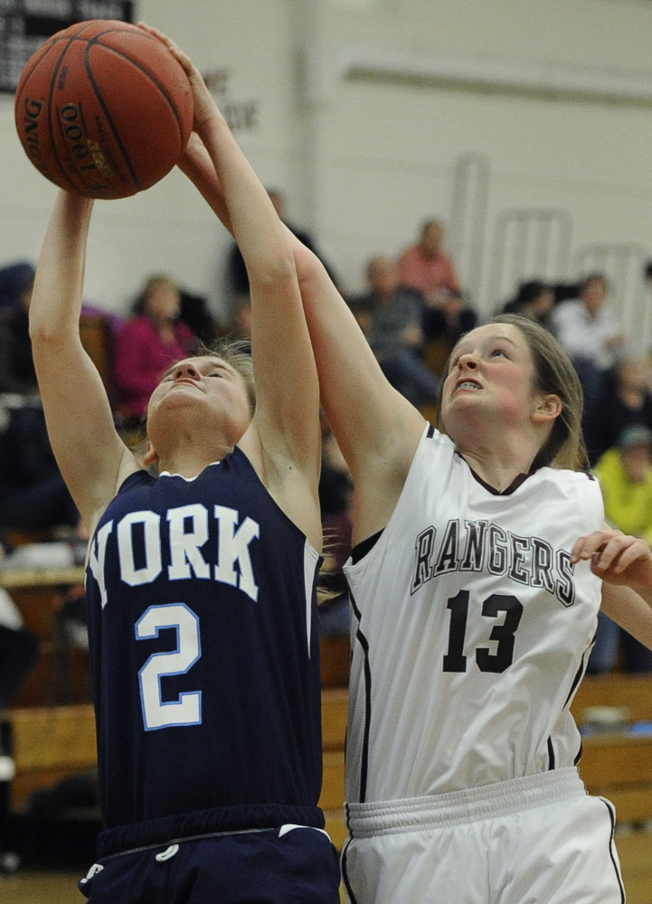 York's Paige McElwain, who led the Wildcats with 11 points, grabs a rebound from Greely's Sarah Felkel, but it wasn't enough as Greely won its seventh game in nine outings.