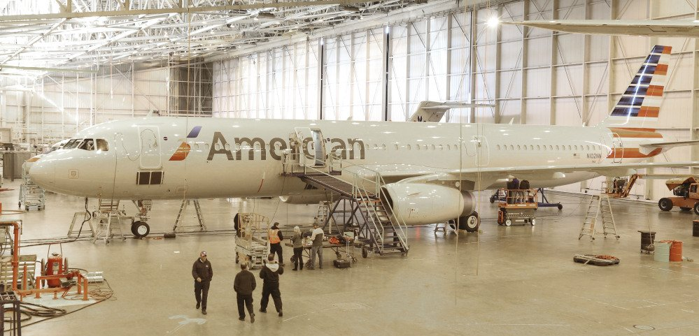 "A new plane is prepared for use at the American Airlines operations center hangar in Grapevine, Texas. American designed the interior of its new planes with the concept that ""your life should never be interrupted because you are flying,"" says Alice Liu, managing director for onboard products for the airline."