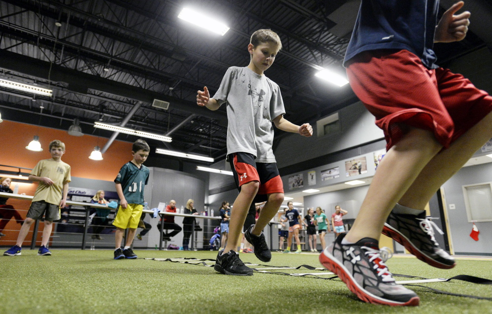 Landon Bickford, 10, of Gorham, center, runs drills with other kids at the Parisi Speed School in Saco.