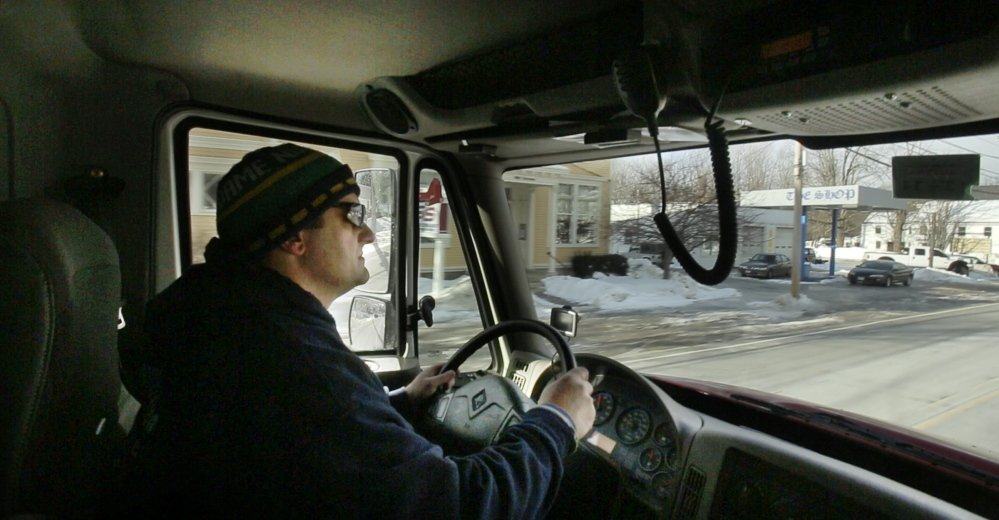 Jim Carroll drives through Limerick village on his way to an oil delivery. Extreme cold and snow and ice storms have made this winter tougher for Maine fuel dealers and their customers, especially those in old homes.