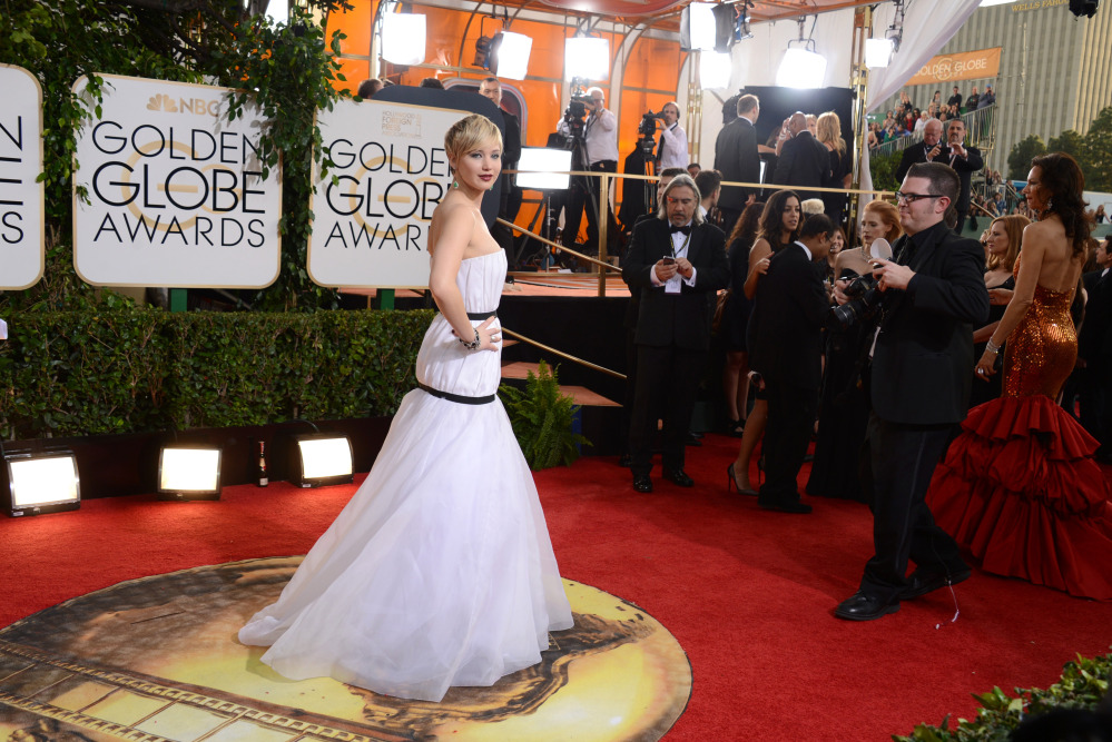 Jennifer Lawrence arrives at the 71st annual Golden Globe Awards at the Beverly Hilton Hotel on Sunday, in Beverly Hills, Calif.