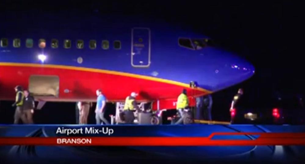 This frame grab provided by KSPR-TV shows a Southwest Airlines flight that was scheduled to arrive Sunday at Branson Airport in southwest Missouri but instead landed at an airport 7 miles north.