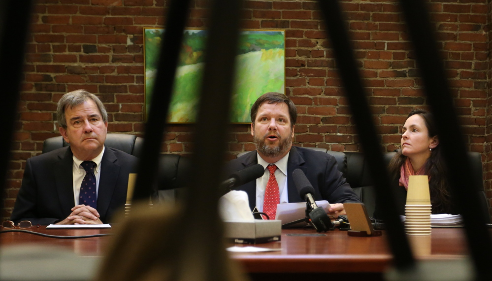 From left, Eric Samp, general counsel for GWI, Fletcher Kittredge, CEO and founder of GWI, and Lauri Boxer-Macomber, attorney with Kelly, Remmel & Zimmerman, announced Monday, Jan. 13, 2013, that GWI is suing Maine Fiber Co. for failure to build the Three Ring Binder fiber-optic network according to the requirements of a federal stimulus grant. (Gabe Souza/Staff Photographer)