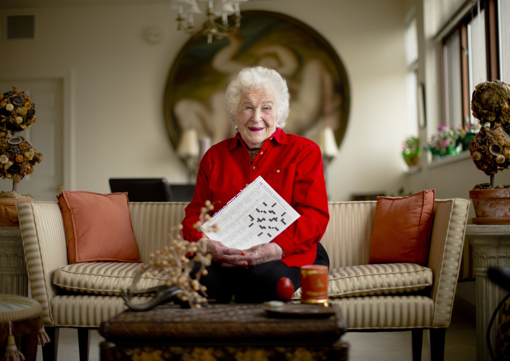 Crossword constructor Bernice Gordon poses for a portrait at her home in Philadelphia. The New York Times is scheduled to publish one of her puzzles, making her the first centenarian ever to have a grid printed in the paper.
