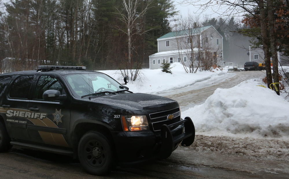 A Cumberland County sheriff's vehicle sits Tuesday morning outside 20 New Road in Casco, one of two homes invaded by armed intruders earlier in the day. Two of the three suspects, upper left, were arrested in Massachusetts and the third in Fryeburg.