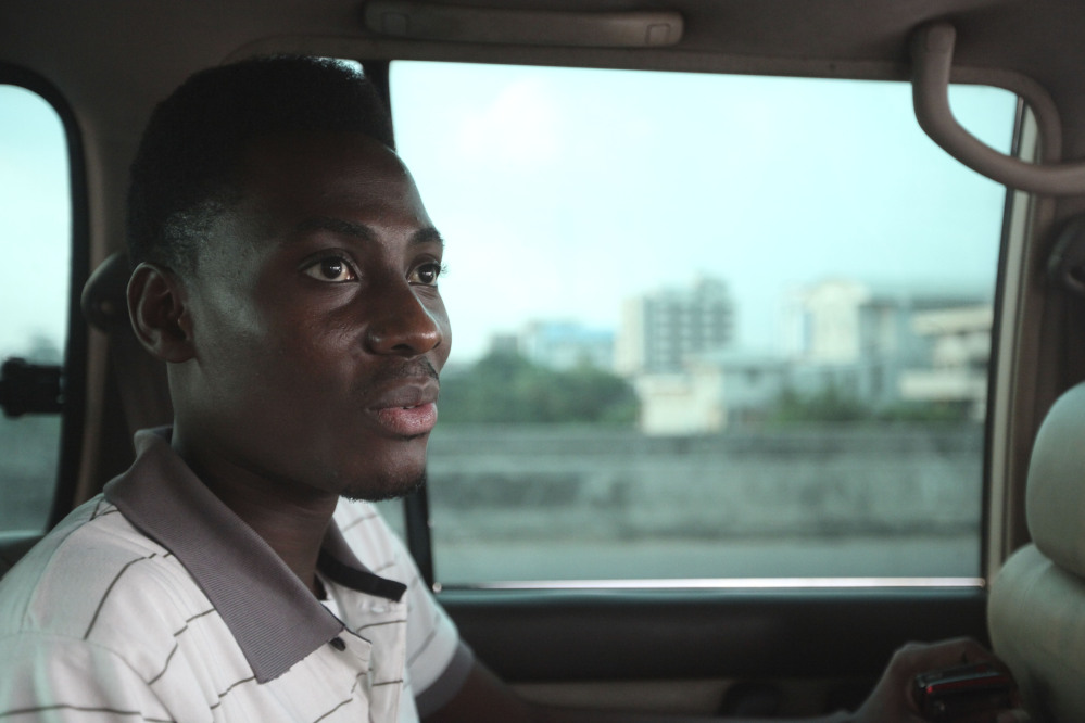 In this Wednesday, Nov. 17, 2011 file photo, Rashidi Williams, a gay man, rides in a car in Lagos, Nigeria. Local and international groups fighting AIDS warned on Tuesday that a new Nigerian law criminalizing same-sex marriage and gay organizations will jeopardize the fight against the deadly disease.
