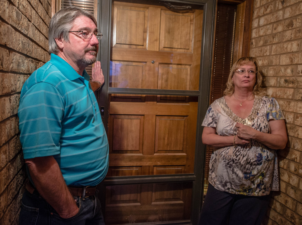 John Masterson and his wife Lea stand outside their door as they talk to the media. Masterson, an eighth-grade teacher, confronted a 12-year-old boy who shot two classmates at the school in New Mexico on Tuesday.