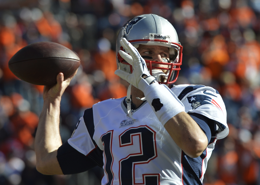Patriots quarterback Tom Brady warms up before Sunday's AFC championship at Denver.