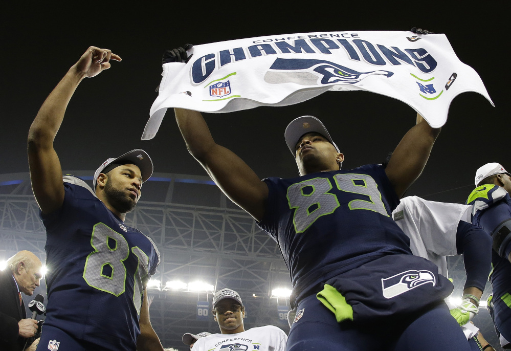 The Associated Press Seattle Seahawks' Doug Baldwin (89) and Golden Tate (81) celebrate after the NFL football NFC Championship game against the San Francisco 49ers, Sunday, Jan. 19, 2014, in Seattle. The Seahawks won 23-17 to advance to Super Bowl XLVIII.