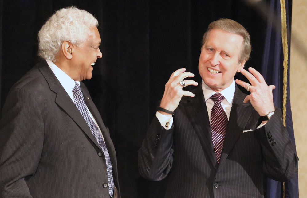 Robert E. Talbot, left, of the NAACP, laughs with former Secretary of Defense William Cohen, a Bangor native, at the annual Martin Luther King Jr. Day breakfast hosted by the Portland chapter of the NAACP at the Holiday Inn by the Bay on Monday.