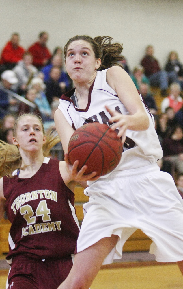 Gorham's Emily Esposito goes up for a shot as Thornton Academy's Ashley Howe watches in Monday's girls' basketball game at Gorham. The Rams won 50-27 to improve to 9-4.