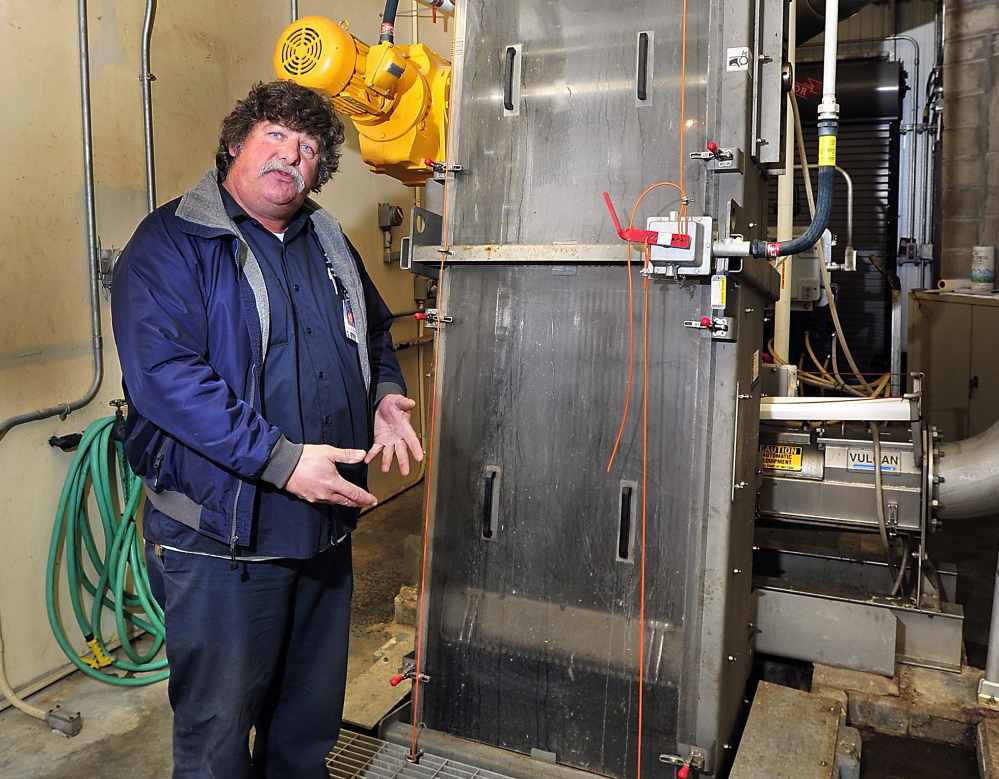 Tom Hume, Operations Foreperson for Wastewater Systems Portland Water District explains the multi-million dollar system device at the in Westbrook that removes baby wipes, paper towels and other items that will clog the pumps as Westbrook partners with INDA, the Association of the Nonwoven Fabrics Industry and the Maine WasteWater Control Association to address the issue of residents flushing baby wipes down the toilet and fouling the sewer system pumps. Gordon Chibroski/Staff Photographer. Tuesday, January 21, 2013.