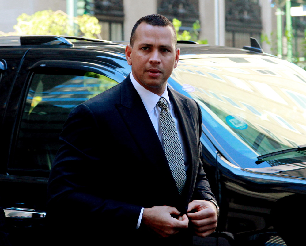 This Oct. 1, 2013 file photo shows New York Yankees' Alex Rodriguez arrivng at the offices of Major League Baseball in New York.