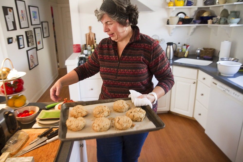 Stacy Cooper makes biscuits in her Arundel kitchen. She plans to open Biscuits & Co. in downtown Biddeford with funding from the Main Street Challenge. Carl D. Walsh / Staff Photographer