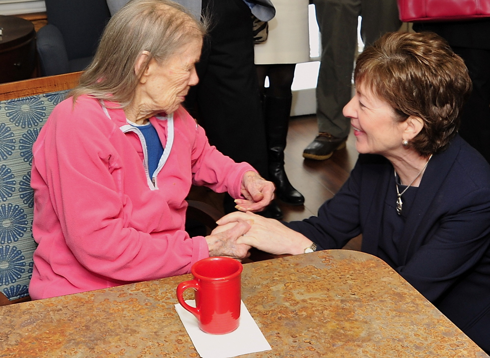 Sen. Susan Collins meets Margaret Randall, 102, a resident of Bay Square in Yarmouth, on Wednesday. Collins praised the retirement home's innovative Alzheimer's treatment.